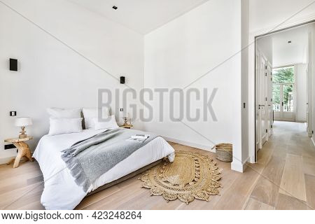 Interior Of A Cozy And Bright Bedroom With Beautiful Bed