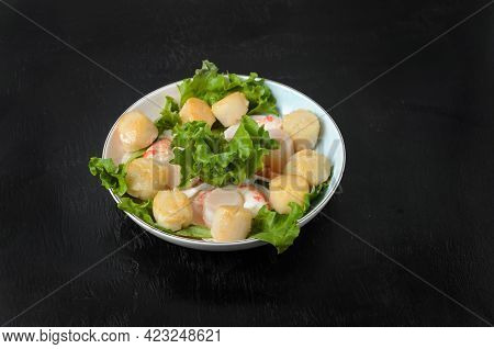 Fried Scallop With Boiled Shrimp Tail With Lettuce Leaves In A Ceramic Plate On A Dark Background. S