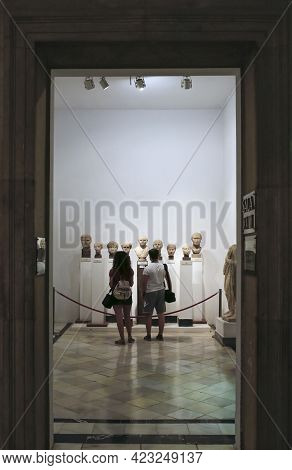 Seville, Spain - July 7th, 2018: Young Couple Visiting Archeological Museum Of Seville, Andalusia, S