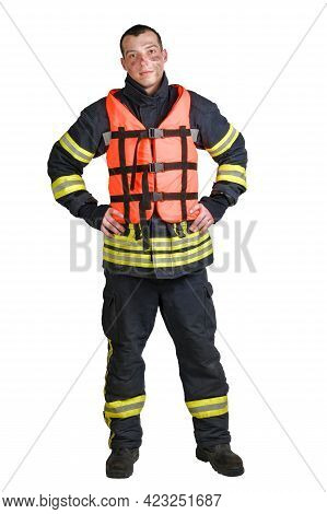 Full Body Young Brave Man In Uniform Of Firefighter And Orange Life Jacket Looking At Camera With Sm