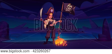 Girl Pirate On Night Beach With Jolly Roger Flag And Sword Near Burning Fire. Filibuster Woman In Ca
