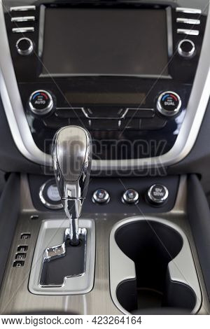 New Modern Car With Automatic Transmission. Modern Transportation. Close Up. Themed Blur Background.