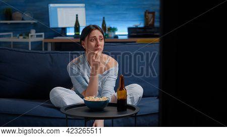 Sad Woman Crying While Watching Drama Movie On Tv Sitting Sofa Eating Popcorn. Sensitive Person Affe