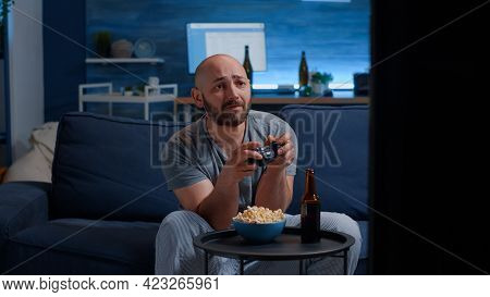 Angry Disappointed Man Losing Video Game Playing With Joystick, Wirelles Joypad. Sad Nervous Home Al