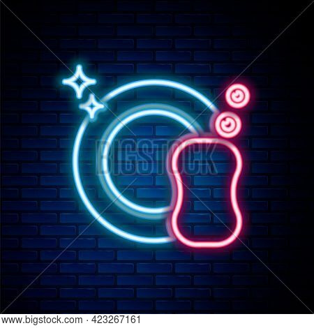 Glowing Neon Line Washing Dishes Icon Isolated On Brick Wall Background. Plate And Sponge. Cleaning
