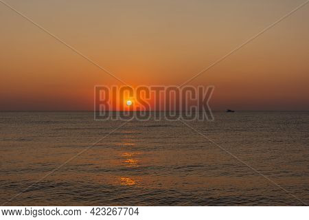 Sunset Sea Boat. Romantic Summer Landscape With A Round Orange Sun. Minimalism In Nature. The Concep