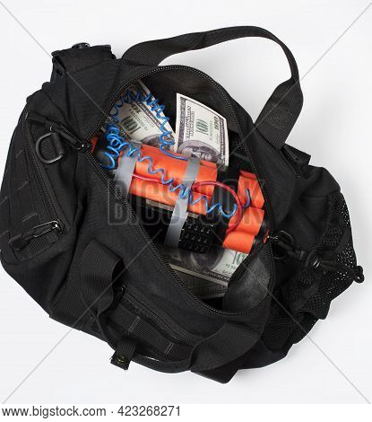 Black Bag With Money And A Timer Bomb From An Old Smartphone. Contract Killing And Terrorism Concept