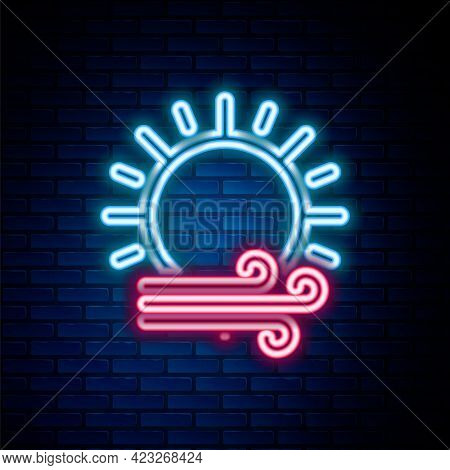 Glowing Neon Line Wind And Sun Icon Isolated On Brick Wall Background. Windy Weather. Colorful Outli