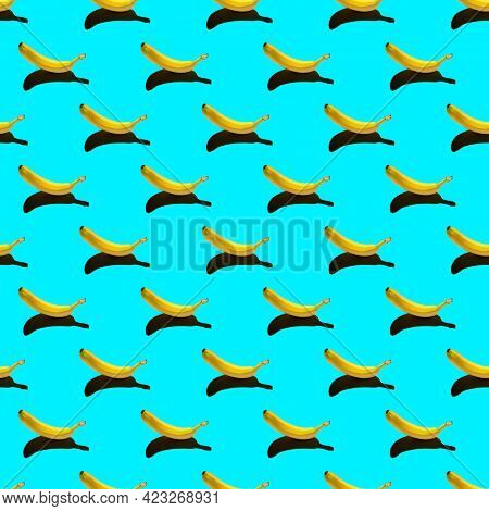 Pattern With Ripe Yellow Banana Isolated On A Bright Blue Background. Hard Shadows From The Sun At N