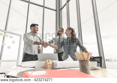 Business People Shaking Hands During A Meeting In The Office, Successful Dealing Concept.