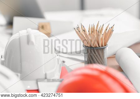 Hard Safety Helmet Hat, Construction Equipment, Blueprint On Table In Office Worker Conference Site,