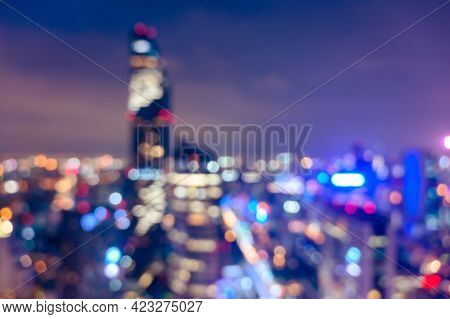 Abstract Blurred Of Urban Night Light. Defocused Of Cityscape At Night. Bokeh Light Background