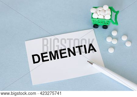 On The Business Card Text Dementia, Next With Pills And Pen