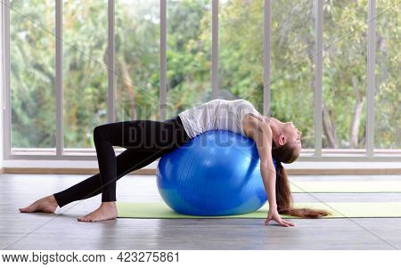 Caucasian Woman Exercising With Exercise Ball. Fitness Girls Flexing Abdominal Muscles With Fit Ball