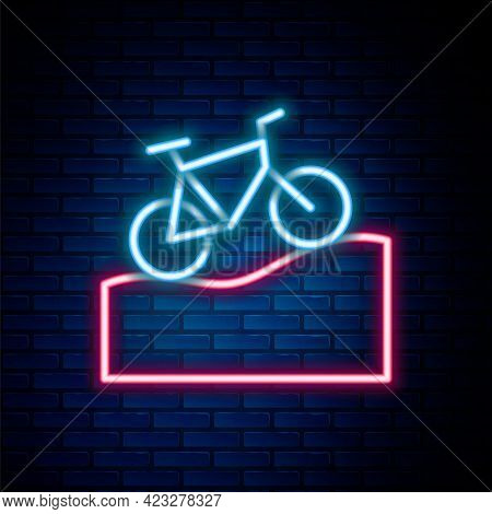 Glowing Neon Line Mountain Bicycle Icon Isolated On Brick Wall Background. Bike Race. Extreme Sport.