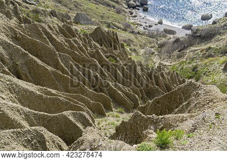 A Bizarre Relief, Formed As A Result Of Soil Erosion And Weathering On A Clay Slope At The Foot Of C