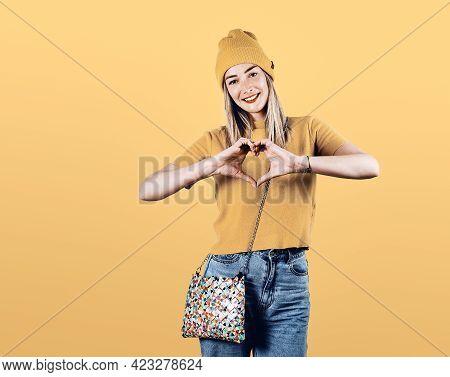 Beautiful woman portrait. Beauty Woman face Portrait yellow. Beautiful model woman portrait on yellow. Woman smiling portrait on yellow background. Beautiful woman smiling. Woman portrait on yellow. Woman face. Woman portrait looking at camera.