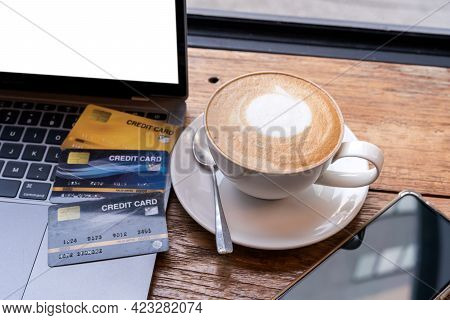 Credit Card Of Laptop Computer,smartphone And Hot Coffee Latte With Latte Art Milk Foam In Cup Mug O