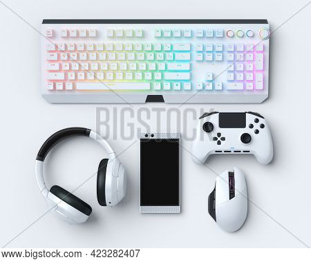 Top View Gamer Gears Like Mouse, Keyboard, Joystick, Headphones And Phone On White Table Background.