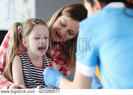 Doctor Collects Biological Material From Child Saliva