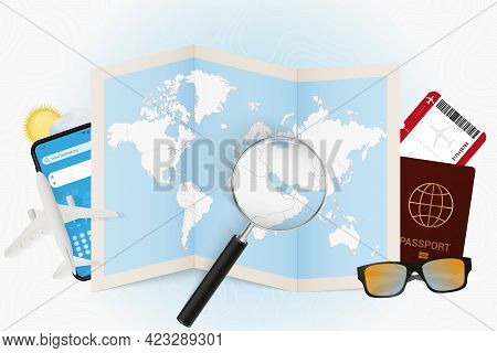 Travel Destination Qatar, Tourism Mockup With Travel Equipment And World Map With Magnifying Glass O