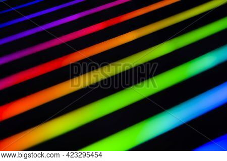 Neon Rainbow Strips On Dark Background. Soft Focus Abstract Rainbow Color Wave Strips Horizontal Bac