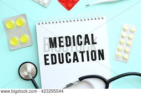 The Text Medical Education Is Written In A Notebook That Lies Next To The Stethoscope, Medicine On A