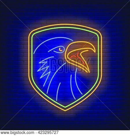 Shield With Crow Head Neon Sign. Bird, Mystery, Logo Design. Night Bright Neon Sign, Colorful Billbo