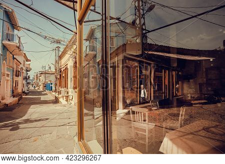 Ayvalik, Turkey: Street Of Small Turkish Town With Cafe And Some Shops In Reflection Of Windows On 2