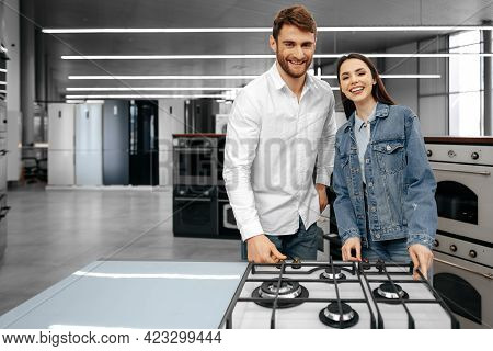 Happy Smiling Couple Just Bought New Household Appliances In Hypermarket