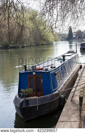 A Narrowboat Moored Along The Thames River In Maidenhead In The Uk, Taken On The 30th March 2021