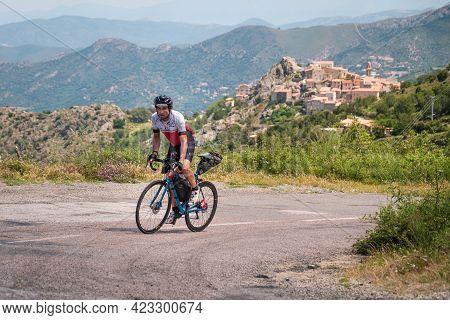 Speloncato, Corsica, France - 9th June 2021: Thomas Dupin Competing In The 2021 Bikingman Corsica Ra