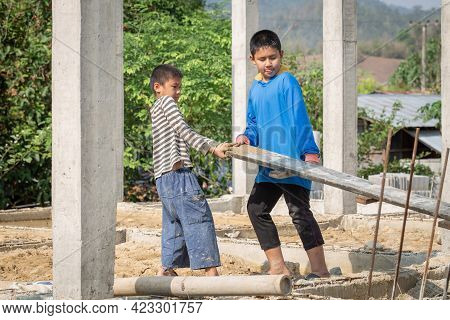 Children Working At Construction Site For World Day Against Child Labor Concept. World Day Against C