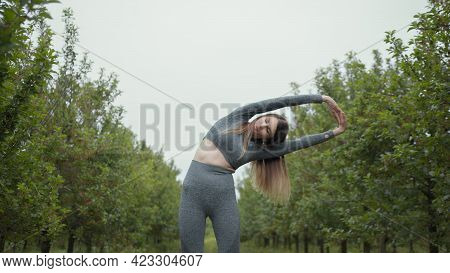 New Normal Sport Outdoor, Young Fit Sport Woman Stretching Her Body Warm Up Before Workout Outdoor.