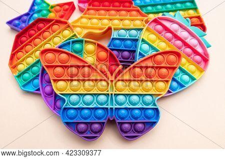Rainbow Push Pop It Bubble Sensory Fidget Toys Of Different Shapes With Butterfly Shape Infront, Sen