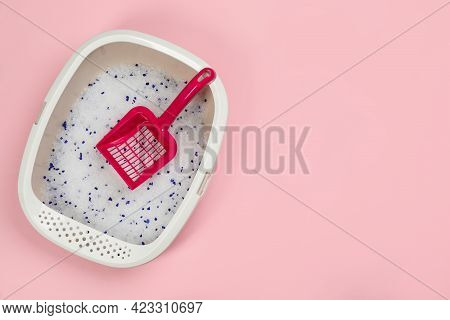 Cat Litter Tray With Filler And Scoop On Pink Background, Top View. Space For Text