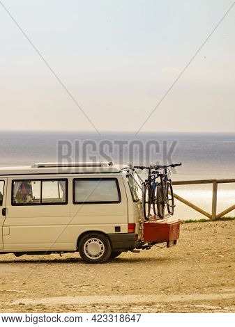 Camper Van With Bicycles On Back Camping On Spanish Coast. Costa Del Sol, Andalusia Spain. Visiting
