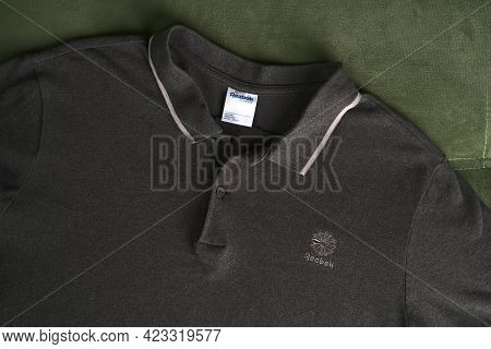 Moscow, Russia - June 8 2021: Dark Grey Reebok Polo Shirt. Simple And Comfortable Clothing For Every