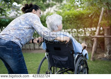 Doctor Help And Care Asian Senior Or Elderly Old Lady Woman Patient Sitting On Wheelchair At Park In