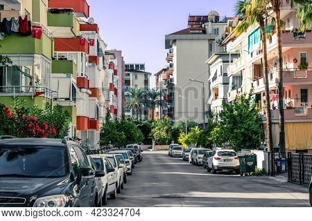 Alanya, Turkey - October 23, 2020: A Lot Of Cars Are Parked Near Multi-storey Buildings On A City St
