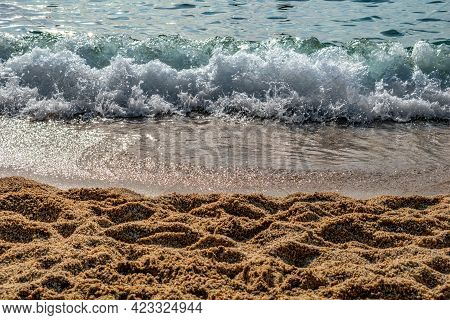 Large-grain Sand Against The Backdrop Of A Sea Wave On The Kleopatra Beach In Alanya (turkey), Close