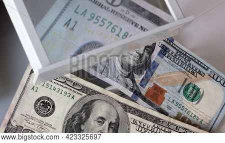 Checking Several Banknotes For Authenticity Through A Magnifying Glass Of A Special Currency Detecto