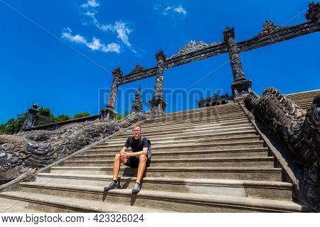 Male Tourist In Beautiful Architecture Photo Of Khai Dinh Emperor Mausoleum, Hue, Vietnam. Popular V