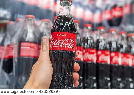 Tyumen, Russia-april 21, 2021: Coca-cola In The Hand Of A Customer In A Hypermarket. Selective Focus