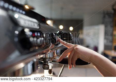 A Barista Prepares A Professional Coffee Machine For Work In A Restaurant Or Cafe. The Process Of Pr