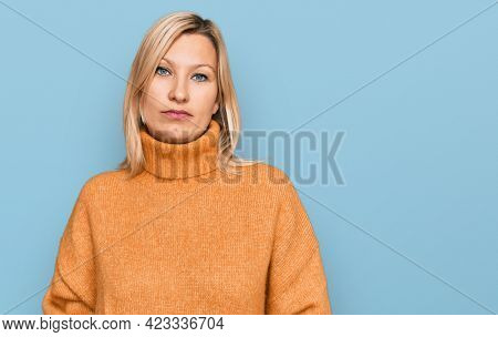 Middle age caucasian woman wearing casual winter sweater looking sleepy and tired, exhausted for fatigue and hangover, lazy eyes in the morning.