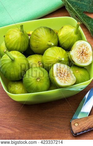 Whole And Cut Green, Fresh And Ripe Figs. With Fig Leaf And Knife. Wooden Background.