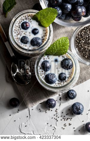Appetizing, Healthy And Refreshing Chia Seed Pudding With Fresh Blueberries And Mint Leaves. Vegetar