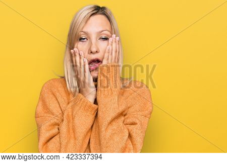 Middle age caucasian woman wearing casual winter sweater tired hands covering face, depression and sadness, upset and irritated for problem