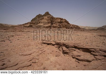 A Desert Landscape With Red Sand And Red Rock Formations, In The Timna Valley Park In Southern Israe